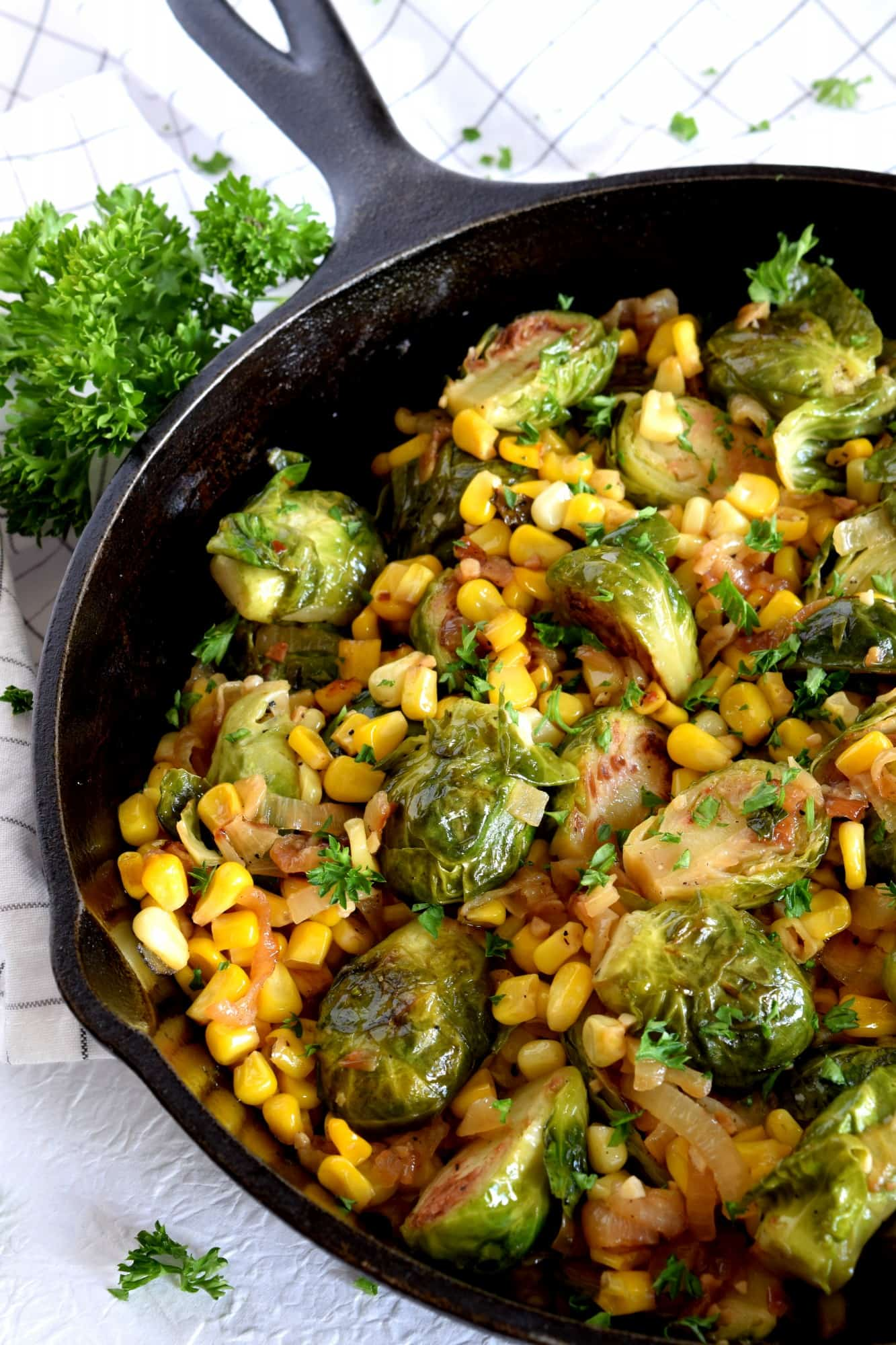 Spicy Pan Seared Brussel Sprouts With Corn And Caramelized Onions