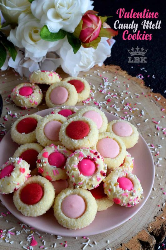 Similar to a classic thumbprint cookie, these valentine cookies use candy melts instead of jam. Makes a great valentine treat for that special someone!#valentine #pink #cookies #candy #melts @wilton