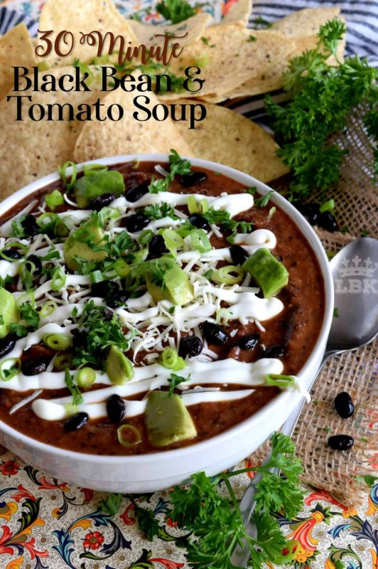 Fast, delicious, hearty, and filling, 30 Minute Black Bean and Tomato Soup is a perfect weeknight dinner fix! This soup is a great crowd-pleasing, comforting cold weather dish!#black #bean #tomato #soup #hearty #family #30minute