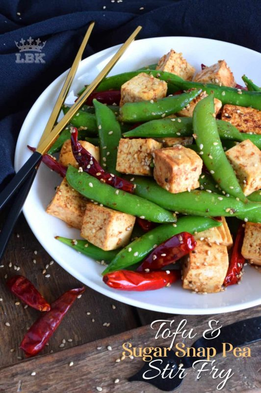 A quick and easy, delicious and nutritious, vegetarian stir fry with tofu and sugar snap peas. Make it spicy or mild, but make a lot of it! This dish is a great meatless dinner option!#tofu #peas #stirfry #recipe #dinner #vegetarian