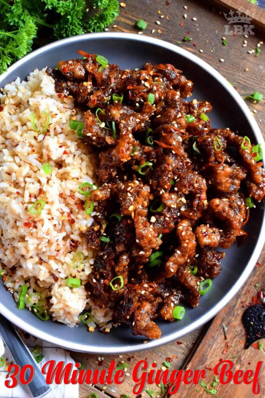Thinly sliced beef, fried until crispy, and coated in a garlic and ginger sauce; 30 Minute Ginger Beef is an expensive dinner the whole family will love!#ginger #beef #takeout #homemade #garlic #fried #crispy