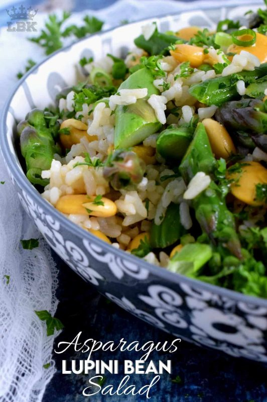 A delicious side salad, yet hearty enough to be a complete meal.  Made with asparagus and canned lupini beans, this dish is great served cold or at room temperature!#asparagus #lupini #bean #rice #salad #summer #picnic #backyard