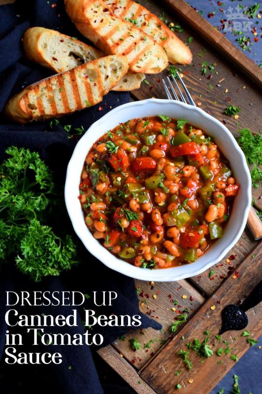 With the help of some fresh veggies and a few spices and herbs, this recipe uses plain canned beans in tomato sauce and transforms it so that it is dressed up and brand new!#canned #beans #tomato #sauce #doctored #dressedup