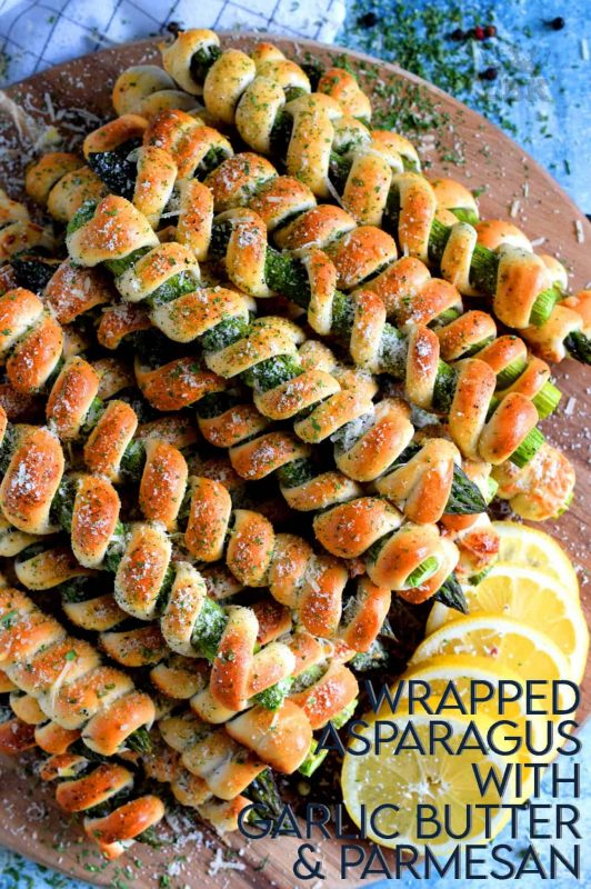 Whether you're looking for a new side dish or an interesting appetizer, Wrapped Asparagus Spears with Garlic Butter and Parmesan is the answer.  Perfectly baked, perfectly seasoned, and perfectly perfect!  Serve hot or at room temperature!#asparagus #wrapped #appetizer #homemade #dough #biscuit #dip #baked #roasted