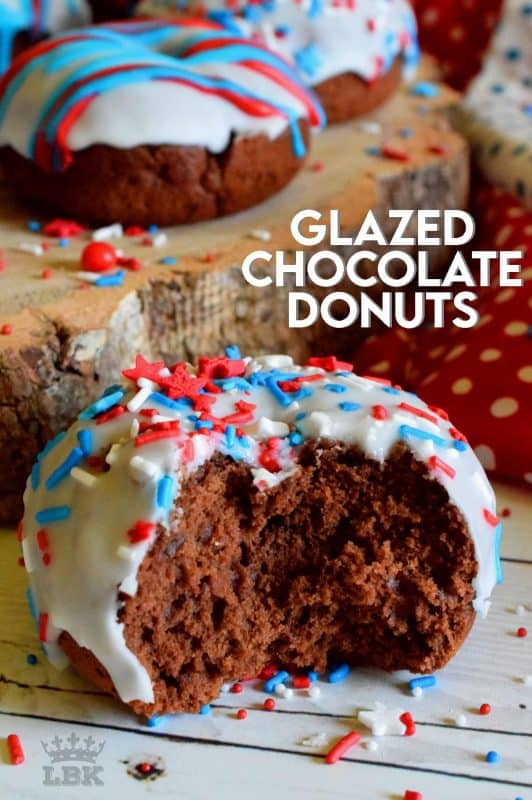 Covered in red, white, and blue frosting and sprinkles, these Glazed Chocolate Donuts scream fourth of July! These will surely be the hit of your family celebrations!#glazed #chocolate #donuts #baked #4thofjuly #sprinkles #patriotic