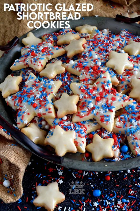 A classic, old-fashioned shortbread recipe that has been festively decorated and garnished to create these beautiful Patriotic Glazed Shortbread Cookies. These are gorgeous and look rather appealing. They make a great gift idea too! #patriotic #4thofjuly #independenceday #baking #redwhiteandblue #redwhite&blue #cookies #sprinkles #shortbread