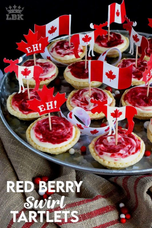 An easy to assemble treat perfect for any Canada Day celebration. Red Berry Swirl Tartlets are flaky, buttery, creamy, and sweet!#canadaday #recipes #redandwhite #tarts #berry #red