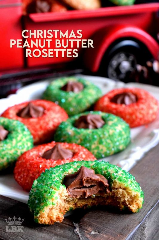 A light and fluffy peanut butter cookie with a milk chocolate rosette center, which has been rolled in sanding sugar.  Christmas Peanut Butter Rosettes will add lots of festive colour and flavour to your holiday baking! #christmas #holiday #baking #peanutbutter #rosette #chocolate #cookies