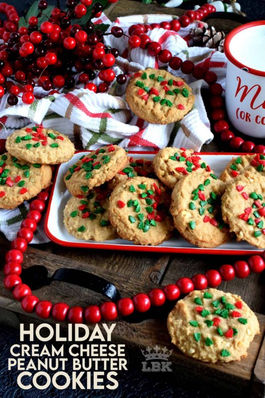 Nostalgia gets an update with these Holiday Cream Cheese Peanut Butter Cookies. Take a classic peanut butter cookie and add cream cheese to get a lighter, flakier, tastier update on your favourite childhood cookie. #holiday #christmas #baking #peanutbutter #creamcheese #cookies #sprinkles