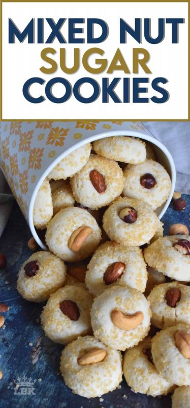 Made with almonds, cashews, and hazelnuts, Mixed Nut Sugar Cookies are a soft, melt-in-your-mouth type of cookie with a crunchy nut baked right on top.  Try eating just one! #sugar #cookies #baking #nuts #almonds #cashews #hazelnuts