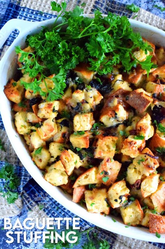 Say good bye to mushy stuffing! Baguette Stuffing with Swiss Chard and Caramelized Onions is chunky, hearty, and vegetarian too! This stuffing is great for any occasion or feast! #stuffing #vegetarian #baked #thanksgiving #meatless