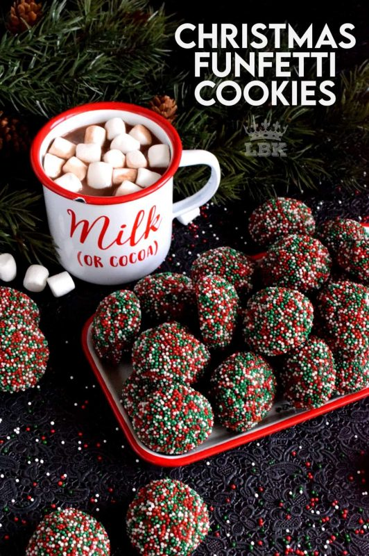 A simple mix, roll, and bake cookie with a deep, rich chocolate flavour.  Christmas Funfetti Cookies are ideal for holiday baking with kids! #christmas #holiday #baking #cookies #funfetti #chocolate #sprinkles #kids