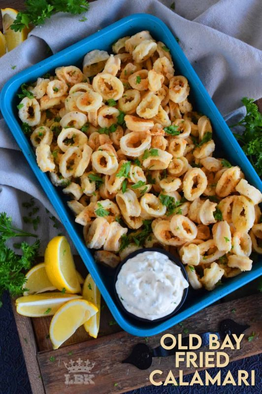 Moist and tender Old Bay Fried Calamari is a perfect appetizer or main.  Prepared with pantry ingredients, serve with tartar sauce and lemon wedges for maximum flavour! #calamari #squid #batter #oldbay #fried