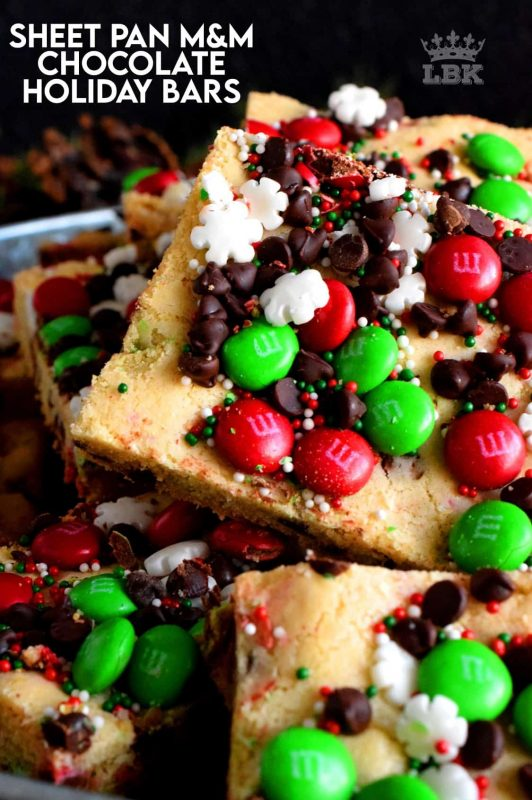 Fast, simple, and easy – just the way Christmas baking should be!  Sheet Pan M&M Chocolate Holiday Bars are festive, fun, and family-friendly! #christmas #holiday #baking #cookies #candy #m&m #sheetpan