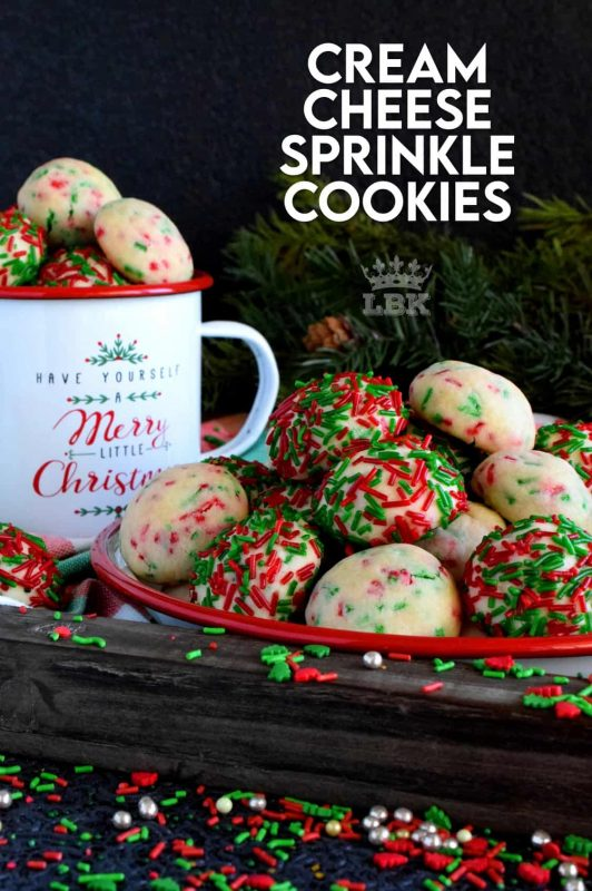 Who doesn't love cheerful and festive Christmas cookies with lots of sprinkles? Made with cream cheese, these taste as great as they look! #sprinkles #cookies #baking #christmas #holiday #balls