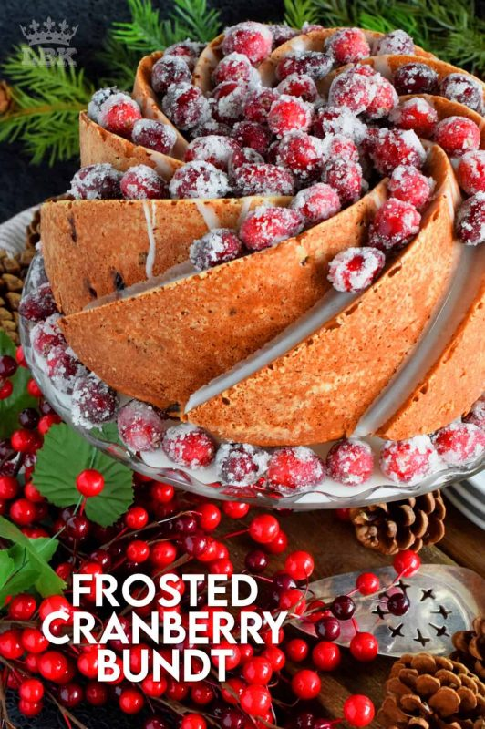 This bundt cake is loaded with whole, fresh cranberries and frosted with a simple icing. Tart, sweet, and perfect for any holiday table! #frosted #fresh #cranberries #cake #bundt #bundtbakers #christmas #holiday