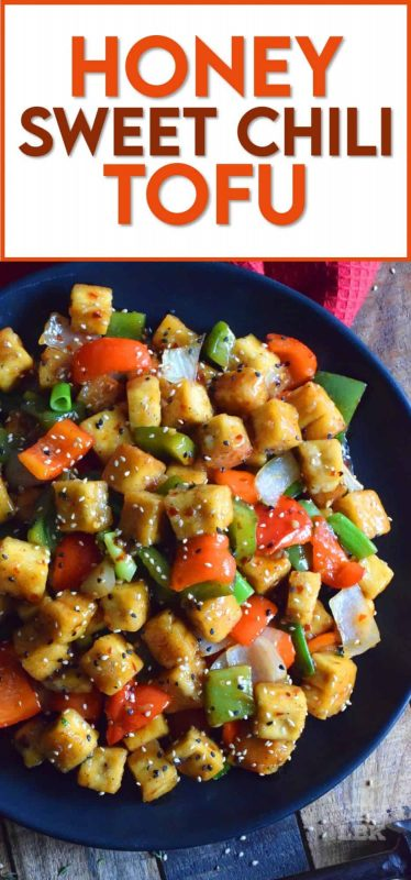 Start with a baked crispy tofu and toss it in a delicious sauce with fresh bell peppers and onions.  Honey Sweet Chili Tofu is a robust and satisfying vegetarian main! #tofu #sweetchili #spicy #peppers #vegetarian