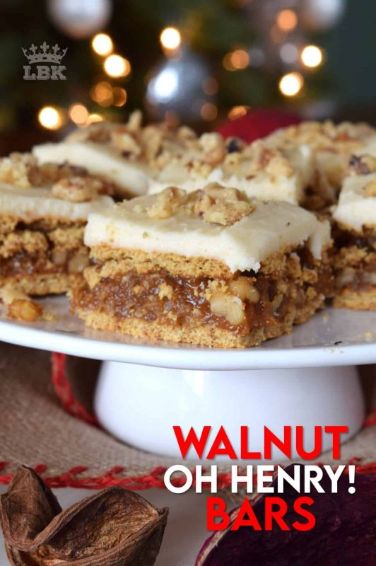 A caramel, walnut, and coconut filling, sandwiched between graham crackers, and topped with a simple buttercream frosting.  Walnut Oh Henry Bars are a deliciously classic Newfoundland Christmastime recipe. #walnut #ohhenry #bars #copycat #christmas #baking #cookies #squares
