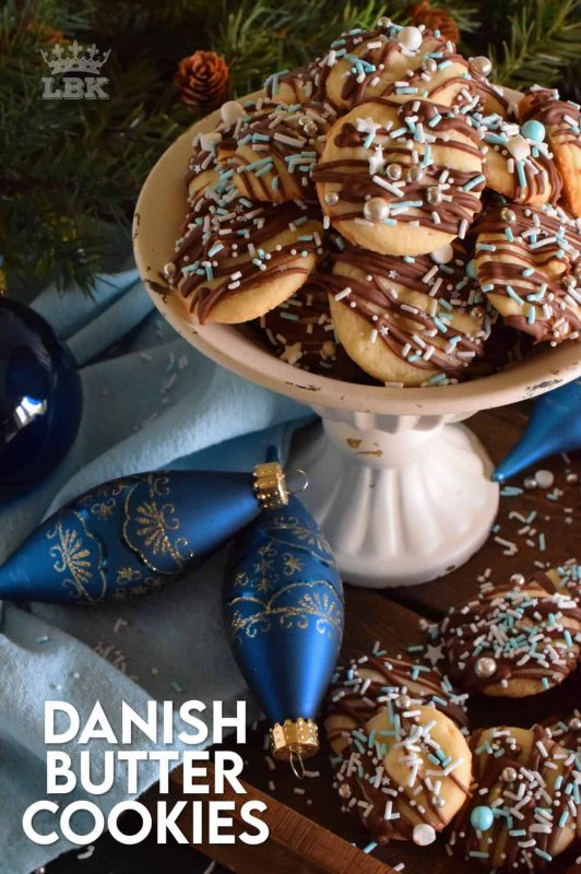 Melt in your mouth Danish Butter Cookies taste just like those cookies in the blue tin at your grandma's house.  But, in this case, they're drizzled with milk chocolate and dressed up with sprinkles! #danish #butter #cookies #christmas #holiday #baking #dansk