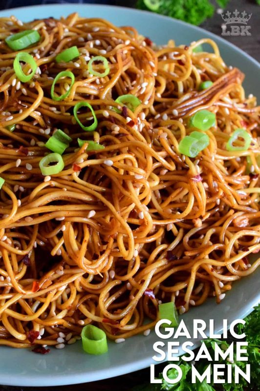 A quick and easy Asian noodle side dish, Garlic Sesame Lo Mein is loaded with classic garlic and ginger flavour, as well as nutty toasted sesame seeds.  Make it as spicy or as mild as you want with dried red chilies! #Asian #garlic #sesame #noodles #lomein #mein #Chinese #homemade
