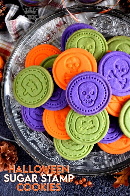 Sugar Cookies are good any time of the year, and Halloween is no exception! A perfect treat for anyone; Halloween Sugar Stamp Cookies are buttery and sugary and delightfully bright and vibrant to match the season! #halloween #cookies #stamp #colours #foodcolouring