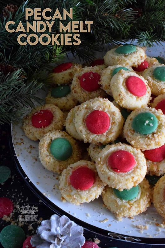 Loaded with chopped pecans, these Pecan Candy Melt Cookies are prepared with cream cheese and topped with a single candy melt.  A soft, nutty cookie with just the right amount of sweetness; and cute too! #pecan #candymelts #wilton #cookies #christmas #holiday #baking