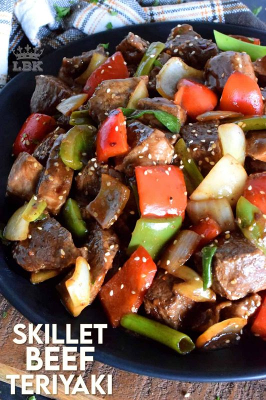 Large pieces of cubed sirloin tip roast is sautéed with peppers, onions, and garlic, in this Skillet Beef Teriyaki dish.  Finish with green onions and sesame seeds for quick and easy main! #skillet #beef #sirloin #tip #roast #teriyaki #sesame #sauce