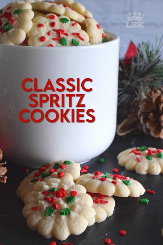 Simple and rustic is the way to go with these super buttery and tender Classic Spritz Cookies.  A melt in your mouth cookie with festive sprinkles for fun and folly!  #classic #spritz #cookies #christmas #holiday #baking #spritzer #press #sprinkles