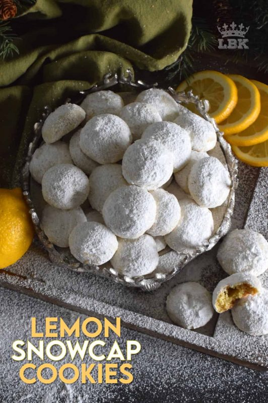 If you love lemon, then get ready to pucker up!  Lemon Snowcap Cookies are delightfully bright and tart; they're soft and moist, and they melt in your mouth.  I bet you can't eat just one! #lemon #lemony #powderedsugar #cookies #snowcap #christmas #holiday #baking