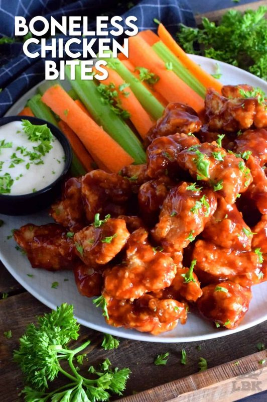 Crispy, fried, battered chicken tossed in your favourite prepared barbecue sauce, Boneless Chicken Bites are a perfect party food.  Serve with fresh veggies, dip, and lots of toothpicks.  There's no need to get your fingers dirty here! #bonelesschicken #barbecuechicken #BBQ #weeknightrecipes