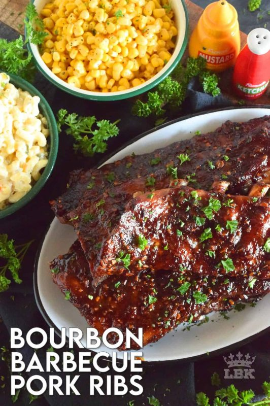 Bourbon Barbecue Pork Ribs are fall-off-the-bone tender. They are slow baked in the oven and basted with a thick and glossy, spicy and sweet, partially homemade bourbon barbecue sauce. Half a rack per person sounds right, yes!? #porkribs #bourbon #barbecue #oven #ribs