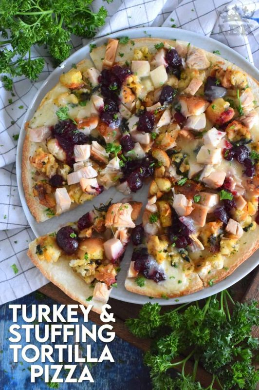 Quick and easy, and a great option for using up holiday leftovers! Turkey and Stuffing Tortilla Pizza has all of the holiday flavours your love on a cheesy, crispy, oven-baked tortilla. Doesn't that sound delicious? #tortilla #pizza #turkey #leftover