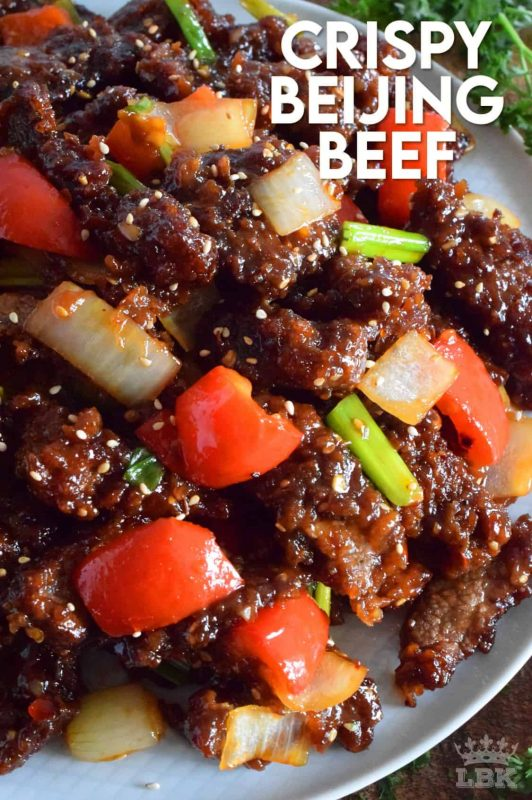 Tender strips of beef, which has been fried until crispy, and then tossed in a sweet, spicy sauce, is what Crispy Beijing Beef is all about!  Prepared with onions and peppers, serve with sticky rice for a complete meal! #crispy #friedbeef #beijingbeef #asianbeef #chinesefood #homemadechinesefood #beef