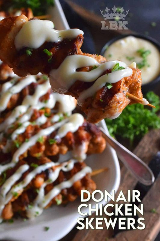 Donair Chicken Skewers are prepared with marinated chicken thighs in a make-at-home Greek seasoning blend, and then grilled to perfection.  Topped with a homemade donair sauce, these skewers will be an immediate new family favourite! #donair #chicken #skewers #grilled #sauce #foodonsticks