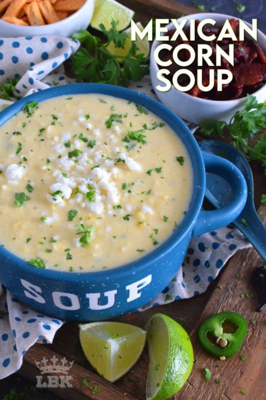 Prepared with sour cream and cream cheese, Mexican Corn Soup is warm and cozy, creamy and cheesy, and has a little bit of heat and zing. Serve with crumbled bacon, tortilla chips, and lime wedges. #mexican #cornsoup #mexicansoup #creamy #cheesy #soup