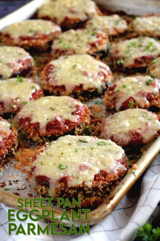 An update on an old Italian classic; this healthier version Sheet Pan Eggplant Parmesan is bursting with flavour.  No need to pan fry the eggplant first!  #eggplant #parmesan #eggplantparmesan #italianrecipes #sheetpan #sheetpanrecipes