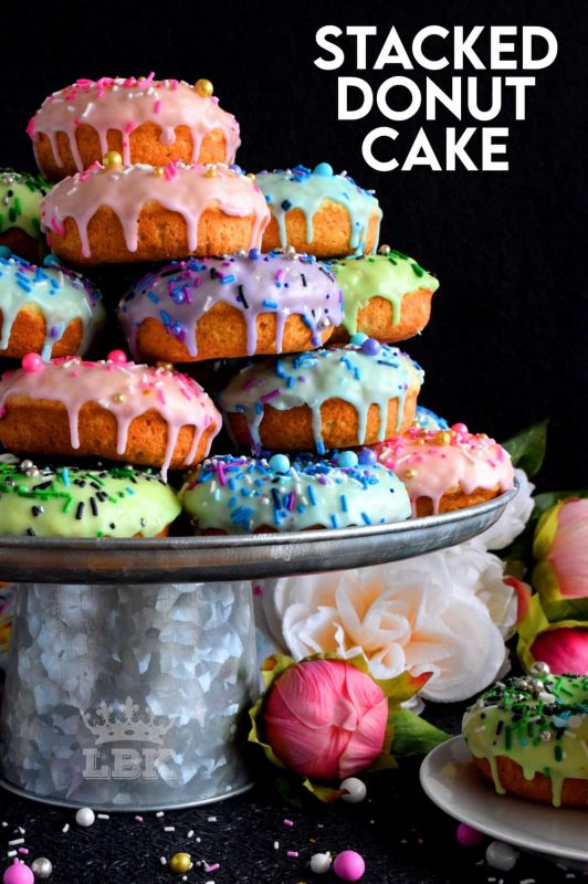 Who doesn't get excited when they see a big pile of donuts?  Sure, you could go to your favourite pastry shop, but you can easily make your own donuts at home.  This Stacked Donut Cake is proof of that!  And, it's perfect for any occasion! #donuts #homemade #stackedcake #donutcake