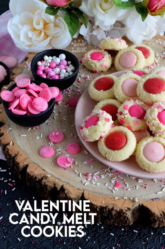 Similar to a classic thumbprint cookie, these valentine cookies use candy melts instead of jam. Makes a great valentine treat for that special someone! #valentine #pink #cookies #candy #melts @wilton