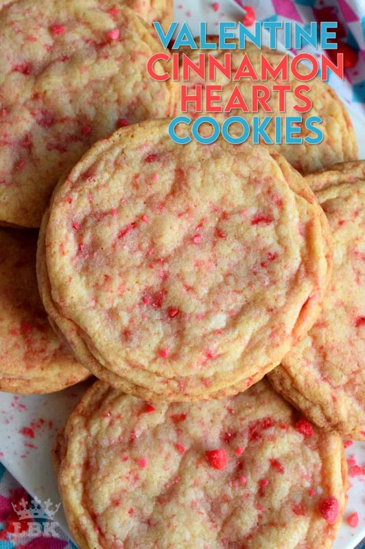 Not all great cookies are soft and chewy.  Valentine Cinnamon Heart Cookies are thin and crispy with a soft, sweet center.  And, they're packed full of everyone's favourite cinnamon candy! #valentinecookies #valentinebaking #valentinetreats #cinnamonhearts #cinnamoncookies