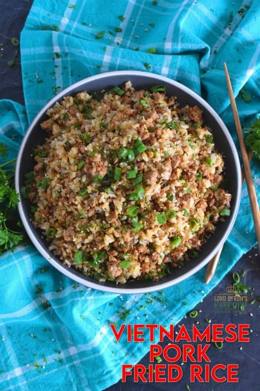 Leftover rice and ground pork are the main ingredients in Vietnamese Pork Fried Rice. Prepared with eggs, garlic, ginger, and green onions, and seasoned with fish sauce, this rice is a complete meal all on its own! #friedrice #pork #vietnameserecipes #porkfriedrice #skillet