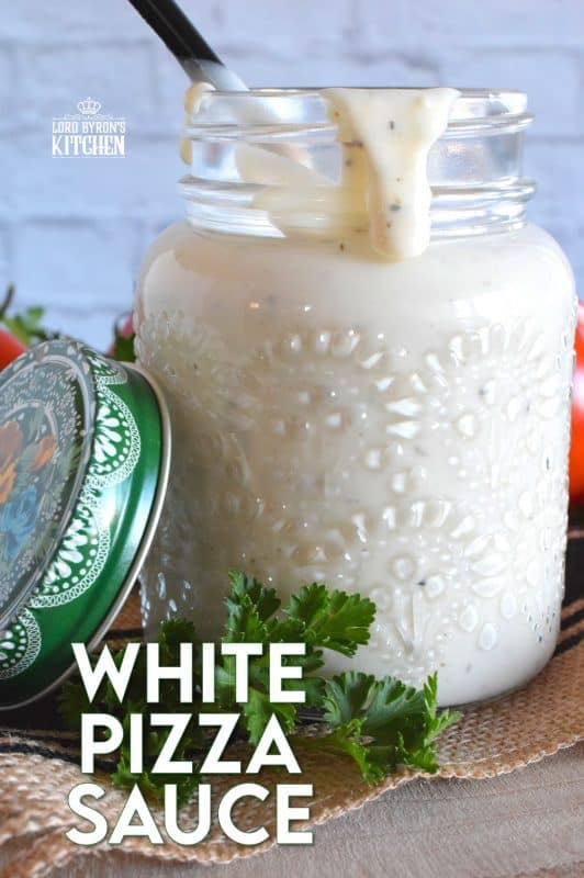 Looking to switch up your homemade pizza? Try switching out the tomato sauce for this White Pizza Sauce! Prepared with lots of garlic, cream, and parmesan, you might want to skip the toppings completely! #pizza #pizzasauce #whitepizza #whitepizzasauce #garlicsauce