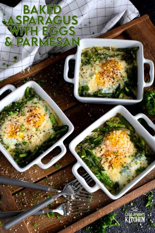 Simple, hearty, and delicious; individual portions make these Baked Asparagus with Eggs and Parmesan easy to serve and a little elegant too! #baked #asparagus #egg #parmesan #brunch