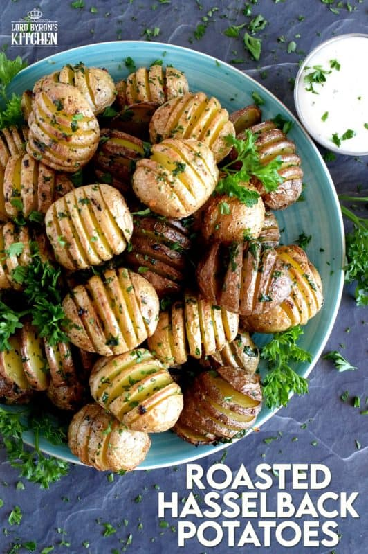A beautiful side dish, a great little appetizer, or eat them all and call it a main!  Roasted Hasselback Potatoes are fast and easy, budget-friendly, and oh, so delicious!  I bet you can't eat just one! #babypotatoes #sidedishes #hasselback #bakedpotato