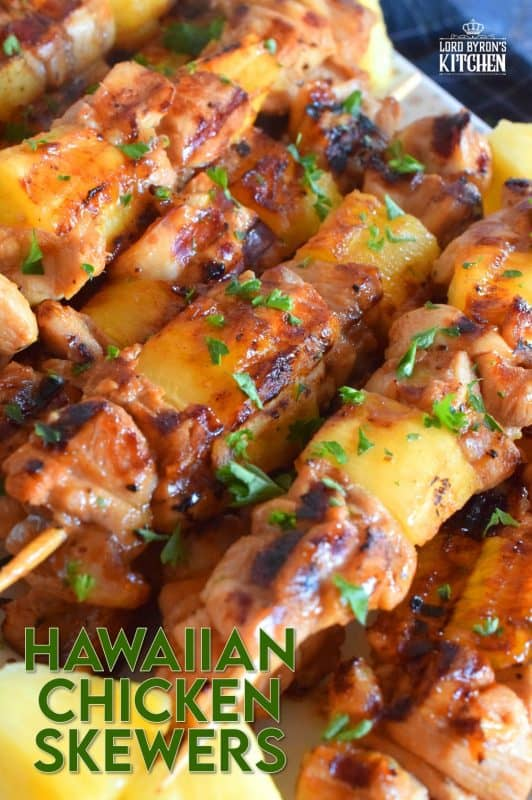 Hawaiian Chicken Skewers are prepared by marinating chicken thighs in mixture of pineapple juice, soy sauce, ginger, garlic, and dry mustard.  Grilled to perfection, with chunks of fresh pineapple, these chicken skewers are absolutely phenomenal! #hawaiian #chicken #pineapple #marinated #skewers #grilledchicken #summer #grilling