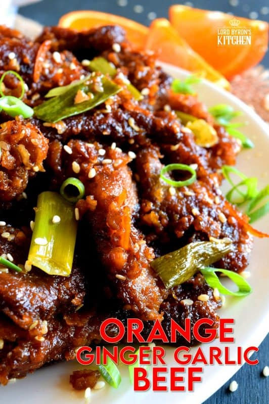 Orange Ginger Garlic Beef is a quick take-out inspired dish which packs a punch of flavour while using just a few fresh ingredients. The cooked beef is tossed in a thick, sweet sauce made with molasses and orange zest. It's absolutely delicious! #orange #beef #crispy #fried #sauce #ginger #garlic