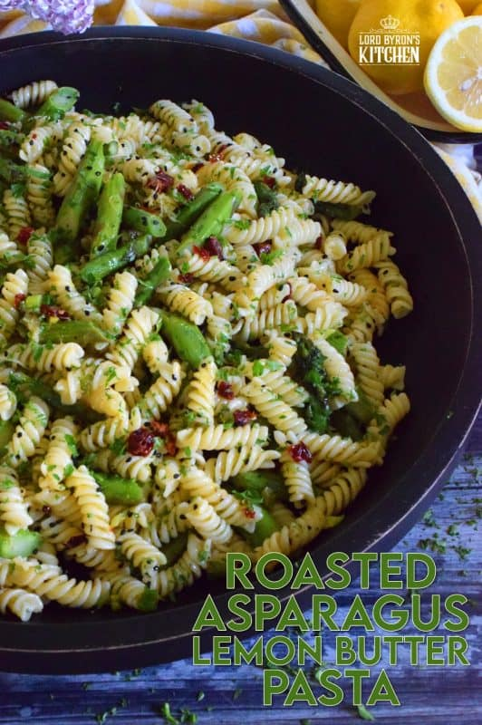 A dish that can only be described as springtime in a bowl, this simple butter roasted asparagus pasta salad, tossed with sun dried tomatoes, fresh lemon, and parmesan.  A delightful cold pasta salad that everyone will love! #asparagus #lemon #butter #pasta #salad