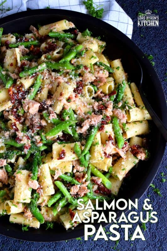 Served warm or hot, Salmon and Asparagus Pasta Salad is a complete meal with so much flavour and texture! The fresh asparagus, lemon juice, and freshly grated parmesan cheese come together to elevate the inexpensive and humble canned flaked salmon! #canned #salmon #asparagus #salad #costco