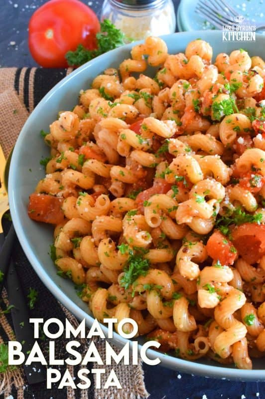 Tomato Balsamic Pasta is prepared with chopped fresh tomatoes and garlic, lots of grated parmesan cheese, and perfectly cooked pasta. With an olive oil and balsamic base, this pasta is super easy, delightfully fresh, and tastes like summer in a bowl! #summerfresh #tomatoes #vegetarian #pasta #oilandbalsamic #freshtomatoes