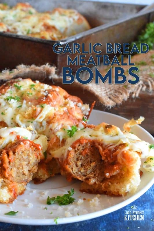 Garlic Bread Meatball Bombs are hollowed out dinner rolls which have been liberally smeared with homemade garlic butter.  Each roll is stuffed with a meatball and sauce, then topped with cheese.  Baked to a bubbling, gooey perfection, these bombs are the bomb! #meatballs #sliders #dinnerrollrecipes #bombs #meatballrecipes #familyrecipes #garlicbread