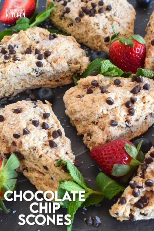 A scone for both the little kids in your life, and the adults that live their lives like a kid, Chocolate Chip Scones are sweeter than regular scones.  With a good splash of vanilla, loads of milk chocolate chips, and a sprinkling of coarse sugar on top, these scones are an absolute treat. #chocolate #chocolatechip #scones #basicrecipes #easyscones #sconerecipe